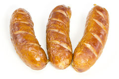 Fried sausages. Three fried sausages on white background Stock Photography