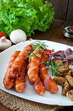 Fried sausages with vegetables Stock Photo