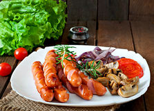 Fried sausages with vegetables Royalty Free Stock Photos