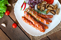 Fried sausages with vegetables Stock Image