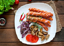 Fried sausages with vegetables Stock Photography