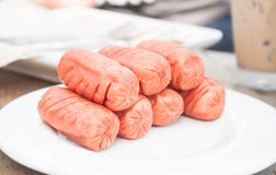Fried sausages on white plate Royalty Free Stock Image