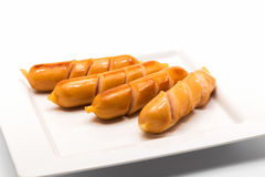 Fried sausages on a white plate  on white. Background Stock Photos