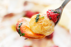Fried scallop with raspberries on a fork Royalty Free Stock Image