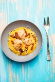 Fried scallops with carrots puree Stock Images