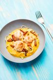 Fried scallops with carrots puree Stock Photo