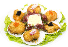 Fried scallops. Decorated with caviar and greens stock images
