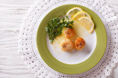 Fried scallops with sauce and lemon. horizontal top view Royalty Free Stock Images