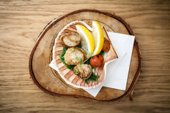 Fried scallops with vegetables Stock Image