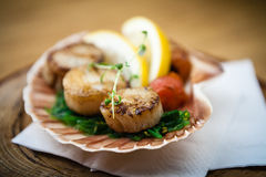 Fried scallops with vegetables Stock Photos