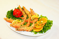 Fried scampi. A plate with fried scampi and vegetables royalty free stock image