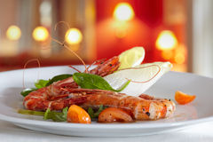Fried scampi with mixed salad and cherry tomatoes Stock Photo