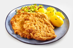 Fried schnitzel with boiled potatoes royalty free stock photos