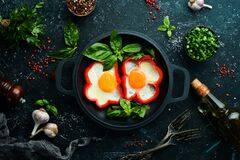Free Fried Scrambled Eggs With Sweet Pepper In A Pan. Royalty Free Stock Photo - 195934745