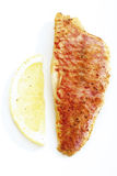 Fried sea barbel with lemon royalty free stock photos