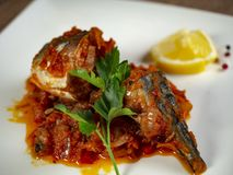 Fried sea bass. Roasted sea bass with beur Noir sauce and caramelized lemon stock photography