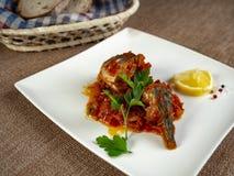 Fried sea bass. Roasted sea bass with beur Noir sauce and caramelized lemon stock image