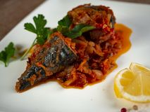 Fried sea bass. Roasted sea bass with beur Noir sauce and caramelized lemon stock images