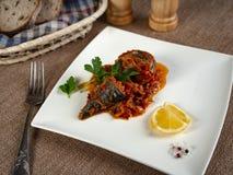 Fried sea bass. Roasted sea bass with beur Noir sauce and caramelized lemon royalty free stock photos