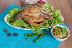 Fried sea perch topped with savory fish sauce menu Royalty Free Stock Photos