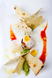 Fried sea scallops with quail egg and guacamole Stock Photo