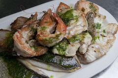 Fried seafood on ceramic plate. Various fried seafood on ceramic plate Royalty Free Stock Photography