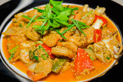 Fried seafood with curry powder Royalty Free Stock Image