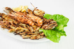 Fried seafood, mixed fry fish. Fried seafood, mixed fry with salade on white dish and background royalty free stock photography