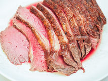 Fried seasoned juicy red meat. On white plate Royalty Free Stock Photos