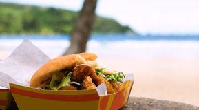 Fried shark and bake fast food outdoors by the beach at Maracas Bay in Trinidad and Tobago. Authentic traditional local Caribbean meal Royalty Free Stock Photography