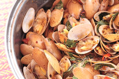 Fried shell in curry sauce - Surf clam Royalty Free Stock Images