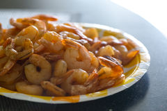 Fried shelled prawns with tails lie on the plate Stock Photography