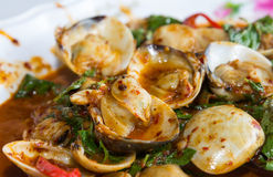 Fried shellfish with chili sauce Stock Image