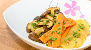 Fried Shiitake mushroom, carrot and potato with butter sauce Royalty Free Stock Images