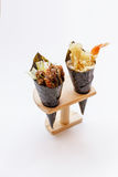Fried Shirauo and Tempura California or Temaki Sushi Hand Roll on Wood Stand Stock Images