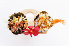 Fried Shirauo and Tempura California or Temaki Sushi Hand Roll on Wood Stand with Red Orchid Royalty Free Stock Photo