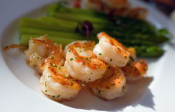 Fried shrimp with asparagus. On white plate Stock Photography