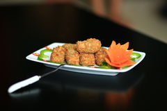 Fried shrimp ball in black royalty free stock photos