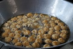 Fried shrimp balls in hot oil the pan. street food royalty free stock images
