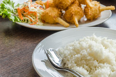Fried shrimp ball on sugarcane skewers and plate of rice Royalty Free Stock Photo