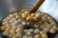 Fried shrimp balls in hot oil the pan. street food royalty free stock photo