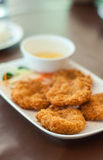 Fried shrimp cake with sweet and sour sauce. On white plate Stock Image