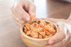 Fried shrimp chins snack in wooden bowl Stock Photos