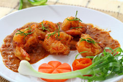 Fried prawn balls in red curry. Stock Image