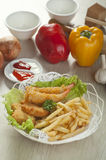 Fried shrimp and fries potatoes Stock Image