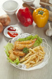 Fried shrimp and fries potatoes Royalty Free Stock Photography