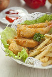 Fried shrimp and fries potatoes Stock Images