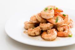 Fried Shrimp with Garlic, White Dish, White Background. Delicious fried shrimps with garlic on white dish and background Royalty Free Stock Images