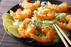 Fried shrimp with green pasta, chili, lime and sesame close-up o royalty free stock images