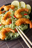 Fried shrimp with green pasta, chili, lime and sesame close-up o royalty free stock photos